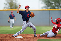 Cleveland Indians Luke Wakamatsu (12) throws to first as J.D. Salmon-Williams (58) slides in during an instructional league game against the Cincinnati Reds on October 17, 2015 at the Goodyear Ballpark Complex in Goodyear, Arizona.  (Mike Janes/Four Seam Images)