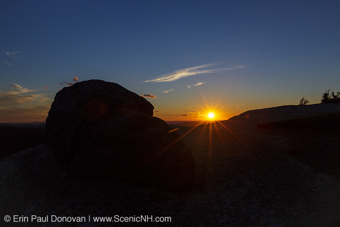 Silhouette of a boulder at sunset from Middle Sugarloaf Mountain in Bethlehem, New Hampshire USA during the summer months.