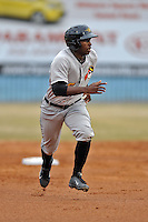 West Virginia Power left fielder Candon Myles #16 runs to third during game one of a double header against the Asheville Tourists at McCormick Field on April 8, 2014 in Asheville, North Carolina. The Power defeated the Tourists 6-5. (Tony Farlow/Four Seam Images)