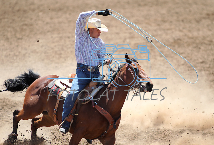 Nick Nalder competes in the team roping event at the Minden Ranch Rodeo on Saturday, July 23, 2011, in Gardnerville, Nev..Photo by Cathleen Allison