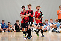 Lachlainn McMahon of Selwyn College celebrates with team mates during the Futsal NZ Secondary Schools Junior Boys Final between Hamilton Boys High School and Selwyn College at ASB Sports Centre, Wellington on 26 March 2021.<br /> Copyright photo: Masanori Udagawa /  www.photosport.nz
