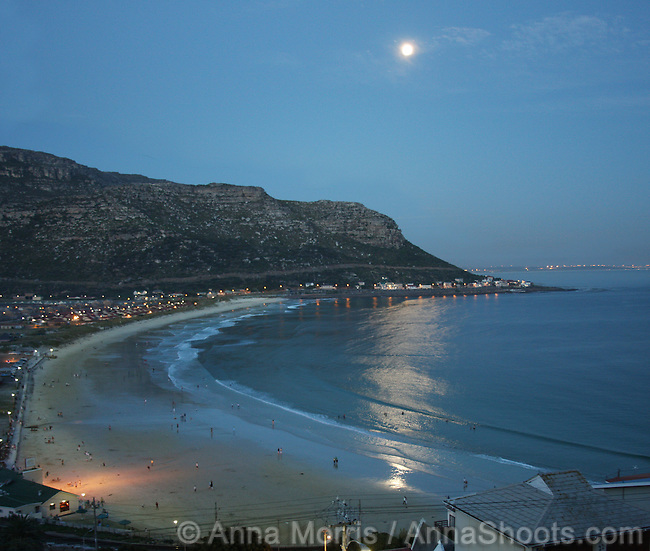 Fish Hoek beach, Cape Town, in all it's summer glory. The bay at sunset and moon-rise. children playing in the sea and a daughter and her mother (Carrie and Julia). And that is really red jellyfish.