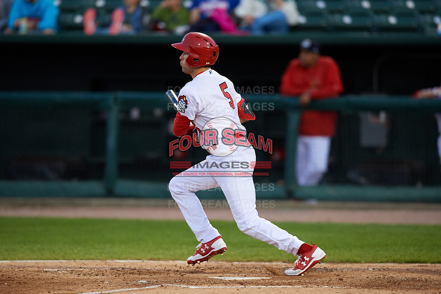 Peoria Chiefs right fielder Dylan Carlson (5) follows through on a swing during a game against the West Michigan Whitecaps on May 8, 2017 at Dozer Park in Peoria, Illinois.  West Michigan defeated Peoria 7-2.  (Mike Janes/Four Seam Images)