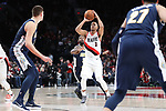 Portland Trail Blazers guard CJ McCollum (3) shoots a three-point shot against the Denver Nuggets in the second half at Moda Center. <br /> Photo by Jaime Valdez