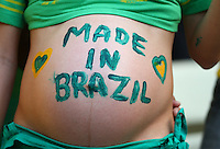 A pregnant Brazil supporter with 'Made in Brazil' painted on her stomach
