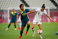KASHIMA, JAPAN - JULY 27: Christen Press #11 of the United States and Mary Fowler #11 of Australia battle for a loose ball during a game between Australia and USWNT at Ibaraki Kashima Stadium on July 27, 2021 in Kashima, Japan.