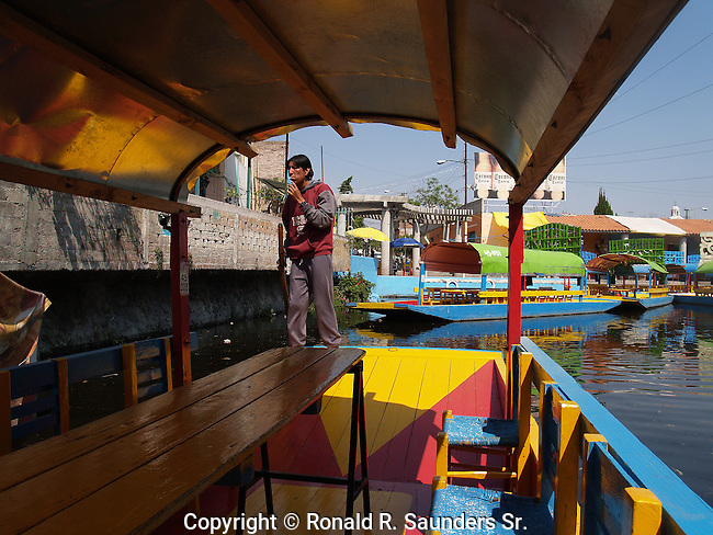 """Xochimilco is one of the sixteen boroughs within Mexican Federal District. Today,the borough consists of eighteen neighborhoods along with fourteen villages that surround it. While the neighbhoods are somewhat in the geographic center of the Federal District, it is considered to be """"south"""" and has an identity separate from the historic center of Mexico City. Xochimilco is best known for its canals, which are left from what was an extensive lake and canal system that connected most of the settlements of the Valley of Mexico. These canals, along with artificial islands called chinampas, attract tourists and other city residents to ride on colorful gondolas called<br /> """"trajineras"""". Its Hispanic past, has made Xochimilco a World Heritage Site."""