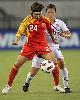 Ali Krieger #16 of the USA WNT covers Yasha Gu #24 of the PRC WNT during an international friendly match at KSU Soccer Stadium, on October 2 2010 in Kennesaw, Georgia. USA won 2-1.
