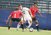 Jimmy Nealis #16 of Georgetown University moves between Ryan Burnham #9 and Nikko Lara #7 of Northeastern University during an NCAA match at North Kehoe Field, Georgetown University on September 3 2010 in Washington D.C. Georgetown won 2-1 AET.