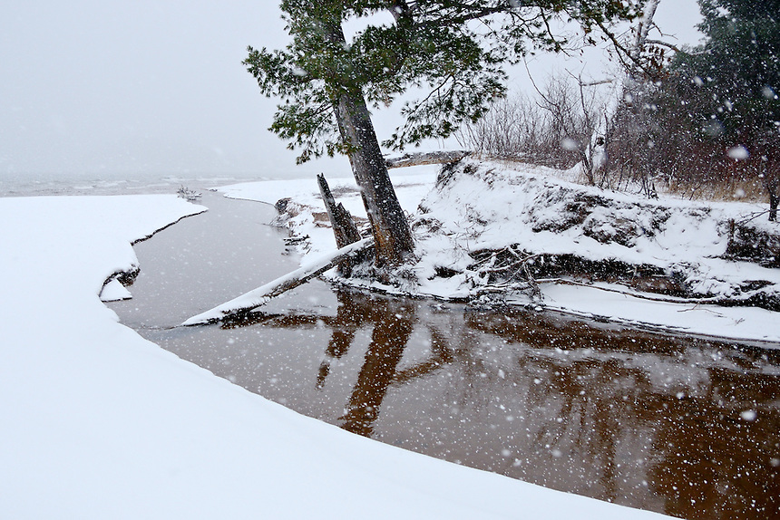 A wintery scene of lake-effect snow at the mouth of Harlow Creek at Little Presque Isle. Marquette, MI