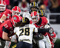 ATHENS, GA - NOVEMBER 09: Brian Herrien #35 of the Georgia Bulldogs is tackled by Jatorian Hansford #28 of the Missouri Tigers during a game between Missouri Tigers and Georgia Bulldogs at Sanford Stadium on November 09, 2019 in Athens, Georgia.