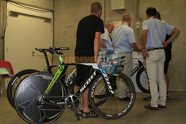 UCI Commisaires check measurements and weight of bikes in the Country Hall, Liege, Belgium before the 2012 Tour de France, Liege, Belgium. 28th June 2012.<br /> (Photo by Eoin Clarke/NEWSFILE)