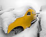 yellow Bombardier under snow
