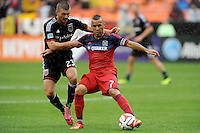 Washington, D.C.- March 29, 2014. Alex of the Chicago Fire shields the ball against Perry Kitchen (23) of D.C. United. The Chicago Fire tied D.C. United 2-2 during a Major League Soccer Match for the 2014 season at RFK Stadium.