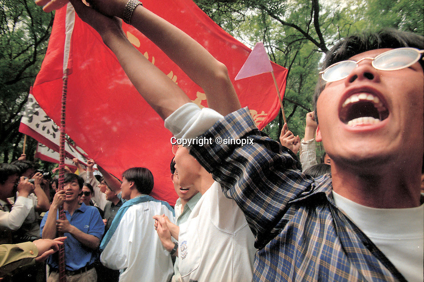 Students take turn and express their angers when passing in front of the US Embrassy. The 8 May NATO's bombarding of the Chinese Embrassy in Belgrade, caused at least four Chinese died, sparks big protest against The US & NATO, even seen for ten years in China..09-MAY-99.