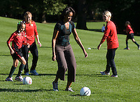 Michelle Obama, Rachel Buehler, Lori Lindsey. Michelle Obama hosted a Lets Move! soccer clinic held on the South Lawn of the White House assisted by members of the USWNT.  Let's Move! was started by Mrs. Obama as a way to promote a healthier lifestyle in children across the country.