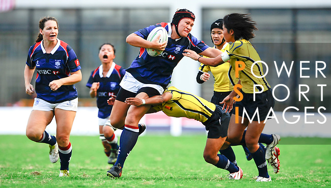 Hong Kong women play Thailand during Day 2 of the Shanghai 7s, part of the HSBC Asian Sevens Series, at the Yuanshen Stadium on August 28, 2011 in Shanghai, China. Photo by © Victor Fraile / The Power of Sport Images for Fast Track / HSBC