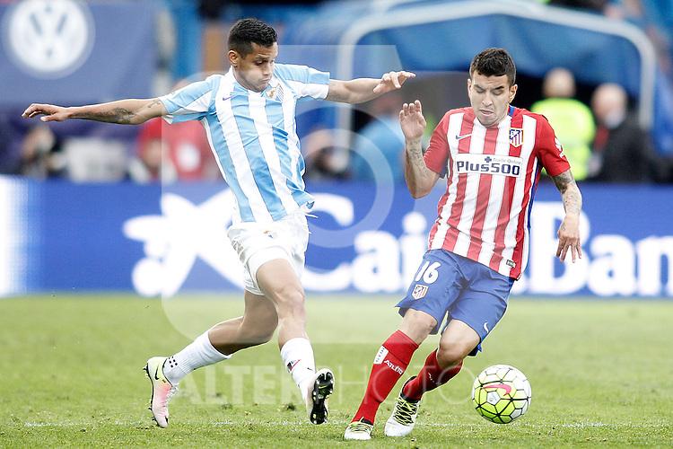 Atletico de Madrid's Angel Correa (r) and Malaga CF's Roberto Rosales during La Liga match. April 23,2016. (ALTERPHOTOS/Acero)