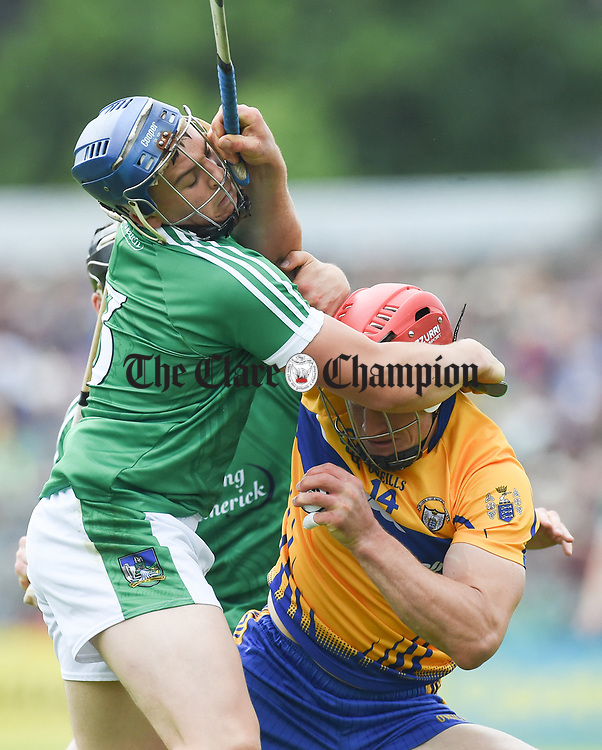 Mike Casey of Limerick in action against John Conlon of Clare during their Munster championship game in Ennis. Photograph by John Kelly.