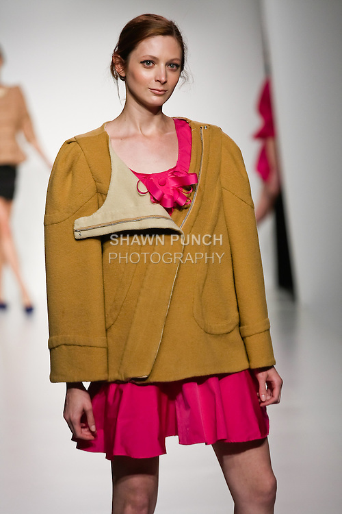 Model walks runway in an outfit from the Surrounded Bodies collection by Abby Dubois, during the Pratt 2011 fashion show.