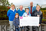 10 year old Callum Robertson from Killorglin did a head shave fundraiser for the Kerry Hospice and presented a cheque for €1000 to them at the unit on Thursday. L to r: Andrea O'Donoghue, Mia Robertson, Joe Hennebry, Callum, Lee and Samantha Robertson
