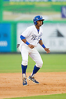 Alex Newman (24) of the Burlington Royals takes his lead off of second base against the Pulaski Mariners at Burlington Athletic Park on July 20, 2013 in Burlington, North Carolina.  The Royals defeated the Mariners 6-5.  (Brian Westerholt/Four Seam Images)