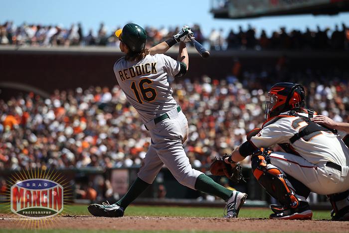 SAN FRANCISCO, CA - MAY 20:  Josh Reddick #16 of the Oakland Athletics bats against the San Francisco Giants during the game at AT&T Park on Sunday, May 20, 2012 in San Francisco, California. Photo by Brad Mangin