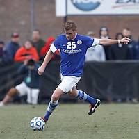 Creighton University defender Jake Brown (25) passes the ball. .NCAA Tournament. Creighton University (blue) defeated University of Connecticut (white), 1-0, at Morrone Stadium at University of Connecticut on December 2, 2012.