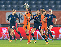 BREDA, NETHERLANDS - NOVEMBER 27: Daniëlle van de Donk #10 of the Netherlands heads the ball in front of Christen Press #23 of the USWNT during a game between Netherlands and USWNT at Rat Verlegh Stadion on November 27, 2020 in Breda, Netherlands.