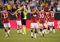 Ryan Giggs (11) of Manchester United salutes the crowd after a friendly match at Lincoln Financial Field in Philadelphia, Pennsylvania.  Manchester United defeated Philadelphia Union, 1-0.