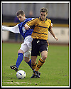 18/01/2003                   Copyright Pic : James Stewart.File Name : stewart-alloa v qots14.ALLOA'S RYAN DAVIDSON IS CHALLENGED BY BRIAN COLLIGAN.....James Stewart Photo Agency, 19 Carronlea Drive, Falkirk. FK2 8DN      Vat Reg No. 607 6932 25.Office     : +44 (0)1324 570906     .Mobile  : +44 (0)7721 416997.Fax         :  +44 (0)1324 570906.E-mail  :  jim@jspa.co.uk.If you require further information then contact Jim Stewart on any of the numbers above.........