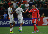 Diego Reyes y Guillermo Ochoa portero de Mexico al finalizar el encuentro   ,durante partido entre las selecciones de Mexico y Guatemala  de la Copa Oro CONCACAF 2015. Estadio de la Universidad de Arizona.<br /> Phoenix Arizona a 12 de Julio 2015.