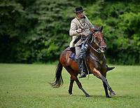 Jesse Phipps of Ringold, Okla., dressed as former Arkansas governor and Confederate military officer Thomas James Churchill, rides his horse Saturday, June 5, 2021, during the Arkansas to Arms event at Prairie Grove Battlefield State Park. Civil War history buffs and re-enactors came to the park for an immersive experience as they portrayed the 1861 recruitment effort for the Confederate States Army for park visitors. The event continues until around noon today. Visit nwaonline.com/210606Daily/ for today's photo gallery.<br /> (NWA Democrat-Gazette/Andy Shupe)