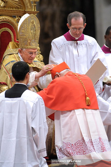 Spanish newly appointed Cardinal Jose Manuel Estepa Llaurens (R) gets his biretta, the square red hat symbolising the blood of the martyrs, from Pope Benedict XVI (L) on November 20, 2010 during a consistory at St Peter's basilica at The Vatican. 24 Roman Catholic prelates joined today the Vatican's College of Cardinals, the elite body that advises the pontiff and elects his successor upon his death.