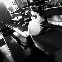 A young Colombian girl sits in the pew before taking part in the First Holy Communion ceremony in the church in Quimbaya, Colombia, 8 December 2013.