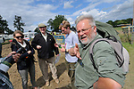 Richard Beddall (2nd from left) and Jean-Paul Laenen (right) at the Dunsfold Collection welcoming point. Dunsfold Collection of Land Rovers Open Day 2011, Dunsfold, Surrey, UK. --- No releases available, but releases may not be necessary for certain uses. Automotive trademarks are the property of the trademark holder, authorization may be needed for some uses.