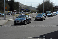 COVID-19 pandemic. Wednesday April 8th 2020<br /> <br /> EBBW VALE, UK - APRIL  8TH   The funeral of Ebbw Vale taxi driver Graham Bright, a victim of the Covid-19 virus. The hurse carrying Graham's coffin leaves the Ebbw Vale taxi rank followed by several of Graham's fellow colleagues on Wednesday 8th April 2020. Graham was very popular with both the Ebbw Vale community and his colleagues and well known as a most helpful and generous person. Graham had no family at all. He simply owned a dog which is now being looked after by someone (Credit: Jeff Thomas | MI News)
