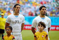 Edison Cavani and Luis Suarez of Uruguay sing their national anthem before kick off