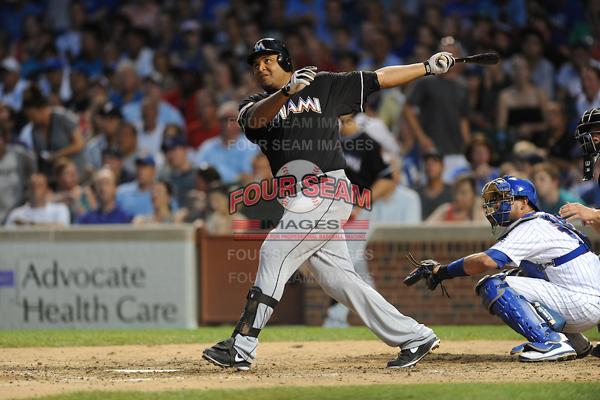 Miami Marlins first baseman Carlos Lee #45 hits a grand slam during a game against the Chicago Cubs at Wrigley Field on July 17, 2012 in Chicago, Illinois. The Marlins defeated the Cubs 9-5. (Tony Farlow/Four Seam Images).