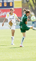 Shannon Boxx (white) kicks the ball past Niki Cross...Saint Louis Athletica and LA Sol, played to a 0-0 tie at Robert Hermann Stadium in St Louis, MO. April 25 2009.