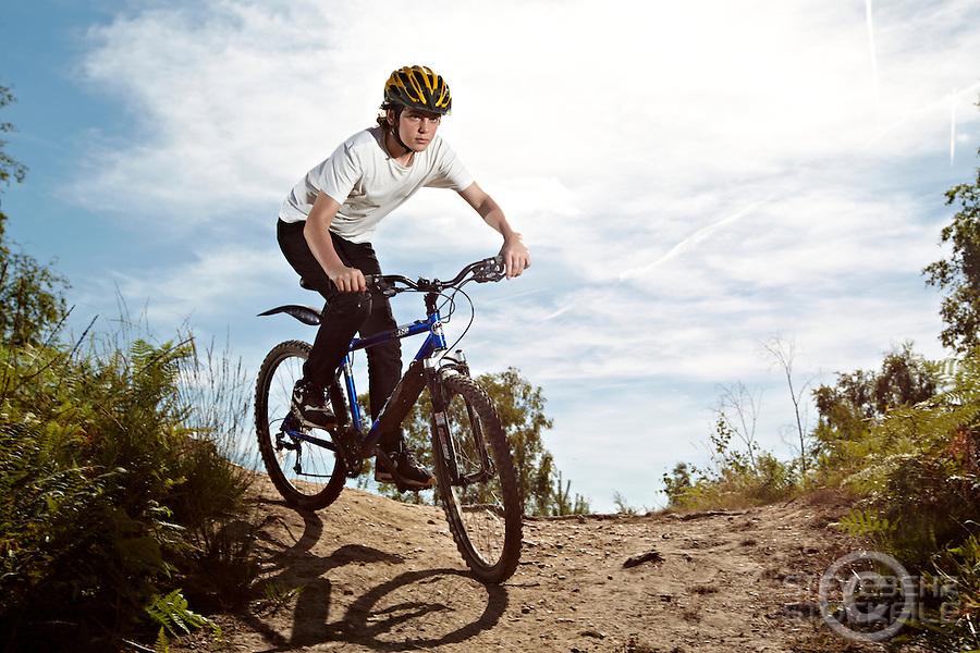 Josh  riding Kona mountain bike , Chobham Common, Surrey.   September    2013.