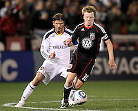 Dax McCarty (10) of D.C. United moves away from David Beckham (23) of the Los Angeles Galaxy during an MLS match at RFK Stadium, on April 9 2011, in Washington D.C.The game ended in a 1-1 tie.