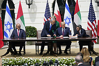 "From left to right: Dr. Abdullatif bin Rashid Alzayani, Minister of Foreign Affairs, Kingdom of Bahrain; Prime Minister Benjamin Netanyhu of Israel; United States President Donald J. Trump and Sheikh Abdullah bin Zayed bin Sultan Al Nahyan, Minister of Foreign Affairs and International Cooperation of the United Arab Emirates sign the ""Abraham Accords"" on the South Lawn of the White House in Washington, DC on Tuesday, September 15, 2020. <br /> Credit: Chris Kleponis / Pool via CNP /MediaPunch"