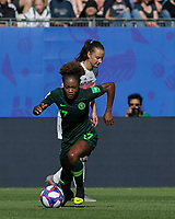 GRENOBLE, FRANCE - JUNE 22: Francisca Ordega #17 of the Nigerian National Team works to clear ball during a game between Panama and Guyana at Stade des Alpes on June 22, 2019 in Grenoble, France.