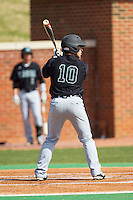 Richard Carter (10) of the Coastal Carolina Chanticleers at bat against the High Point Panthers at Willard Stadium on March 15, 2014 in High Point, North Carolina.  The Chanticleers defeated the Panthers 1-0 in the first game of a double-header.  (Brian Westerholt/Four Seam Images)