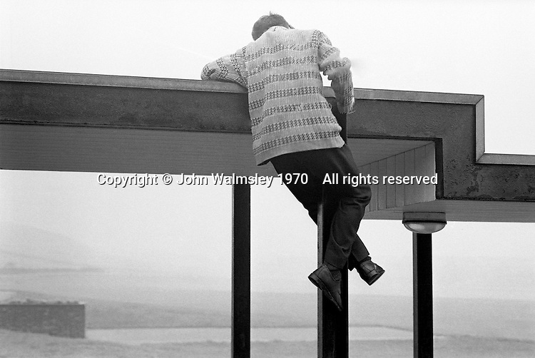 Climbing onto the school roof, Whitworth Comprehensive School, Whitworth, Lancashire.  1970.
