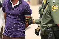 El Paso, Tx - NEWS:   Ride along with Customs and Border Protection agents, El Paso, Tx, Monday, April 29, 2019.<br /> <br /> <br /> PICTURED:  Honduran migrant Jose Noel Baca Paz, 25, is questioned and searched after turning himself in to Border Patrol agents near the border fence. <br /> <br /> <br /> (Angel Chevrestt, 646.314.3206)