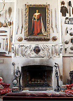 Inside the house on the Clandeboye estate, which is the home to Lady Dufferin, Marchioness of Dufferin and Ava. The inner hall, weaponry, heraldy and hunting prizes line the wall. Many treasures and curiosities were brought back to Clandeboye by the 1st Marquess.