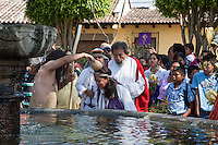 John the Baptist  Baptizing the Faithful.  Palm Sunday Re-enactment of events in the life of Jesus, by the group called Luna LLena (Full Moon), a group of volunteers in Antigua, Guatemala.