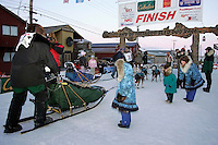 Thursday  March 15, 2007   ---- Nome, Alaska.  Sonny Lindner crosses the finish line in Nome as his family watches from the sidelines.  Sonny finished in 25th place.